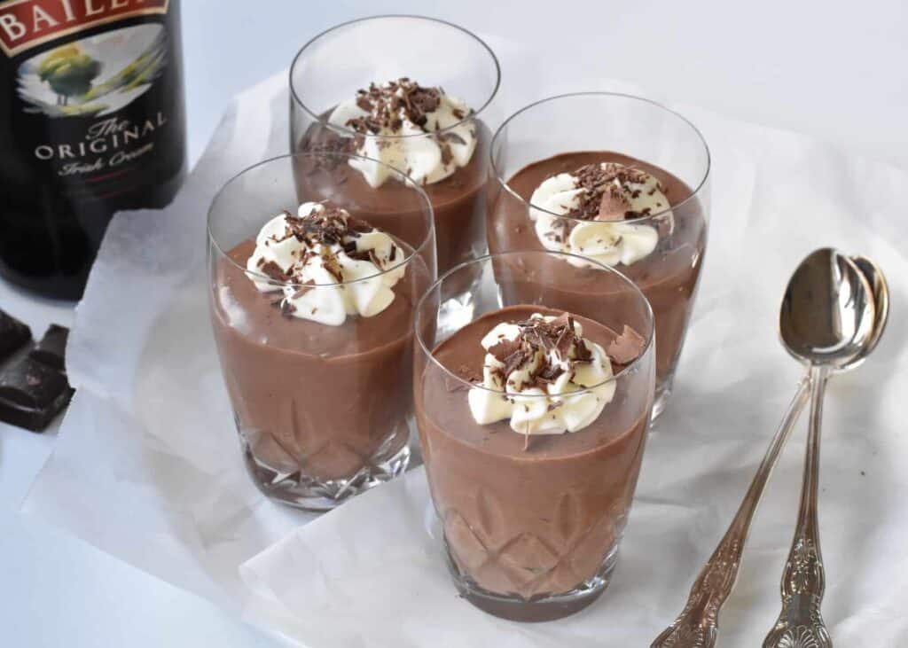 Baileys Chocolate Mousse in glasses with spoons.