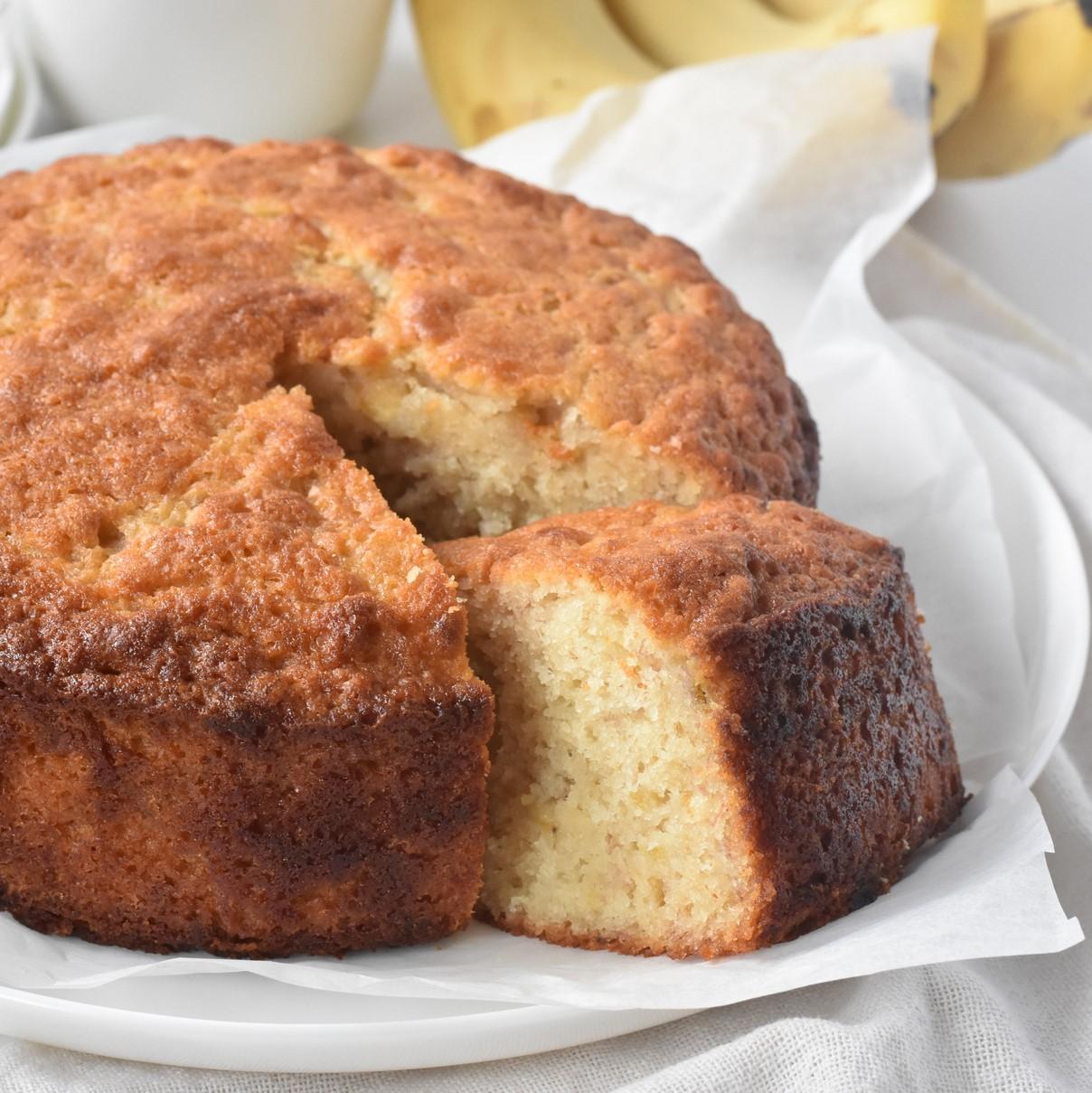 Easy Banana Cake sliced and on display.