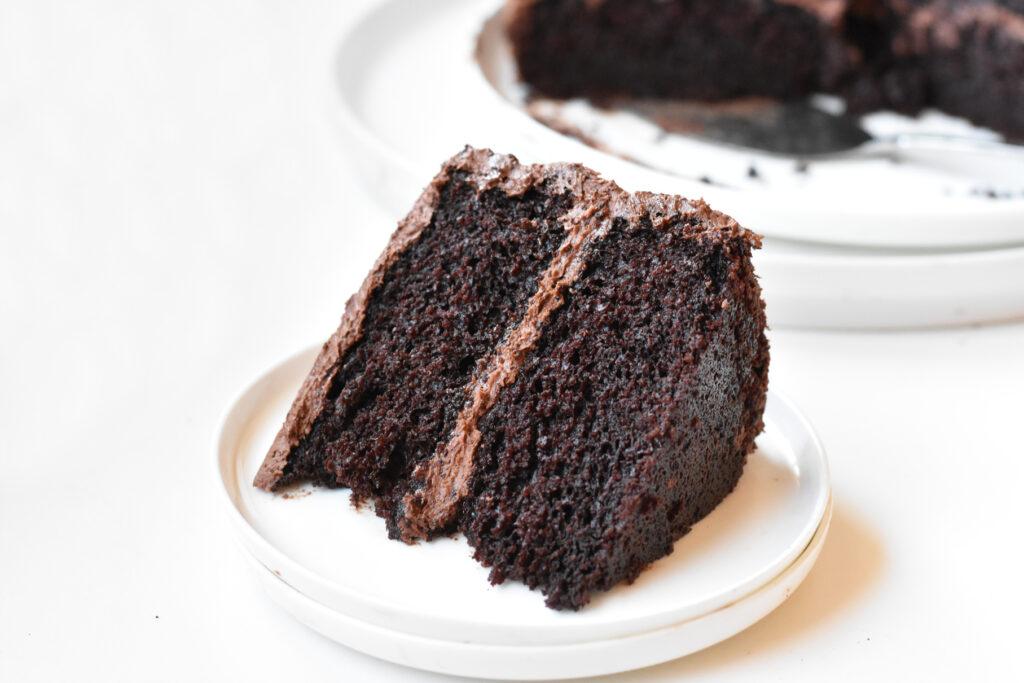 Slice of Devils Food Cake on a plate.