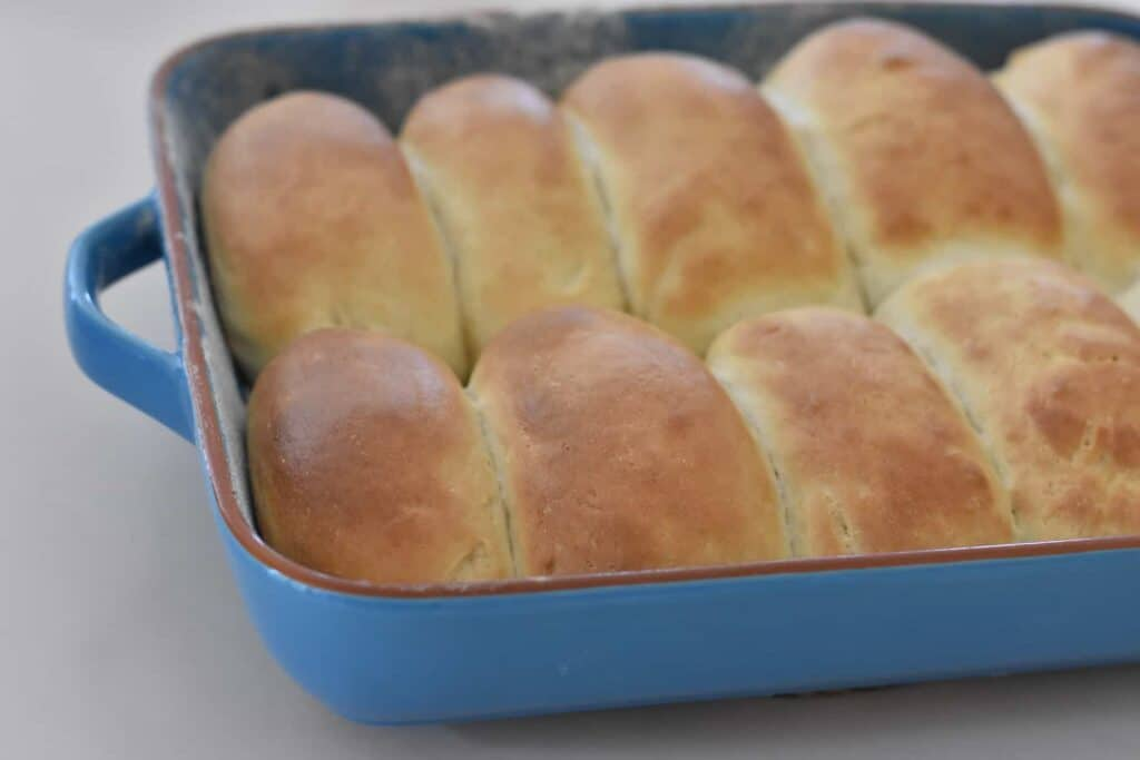 Finger buns after baking dough in tray.