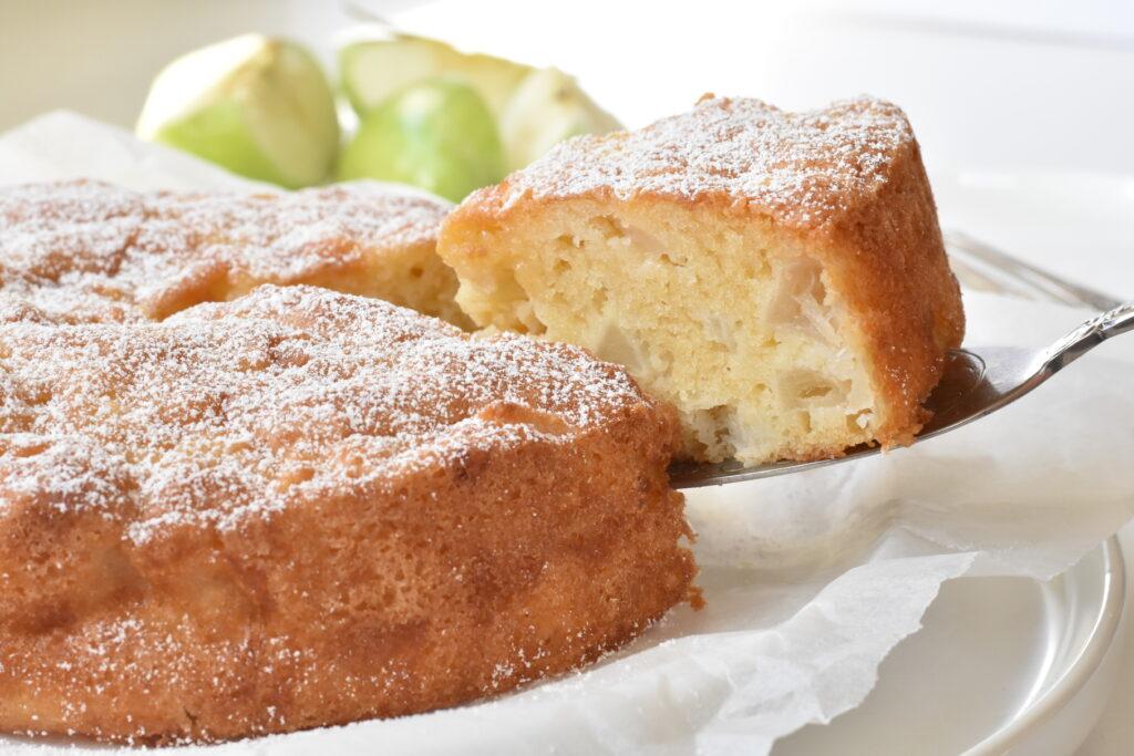 Slice of french apple cake on server.
