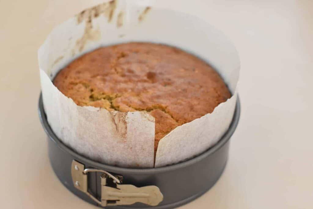 Cooked hazelnut cake in tin.