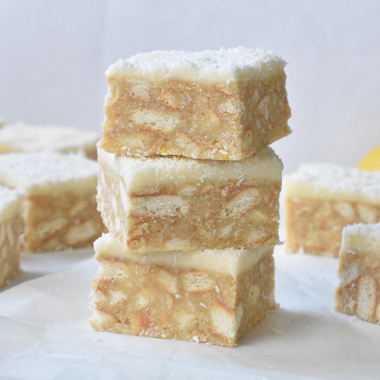 Lemon Coconut Slice squares stacked.