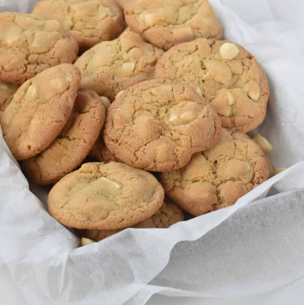 White Chocolate Macadamia Nut Cookies sitting in a pile.