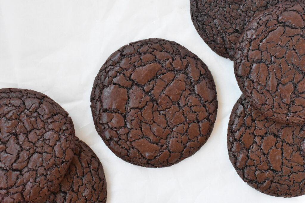 Fudgy brownie cookies on baking paper.