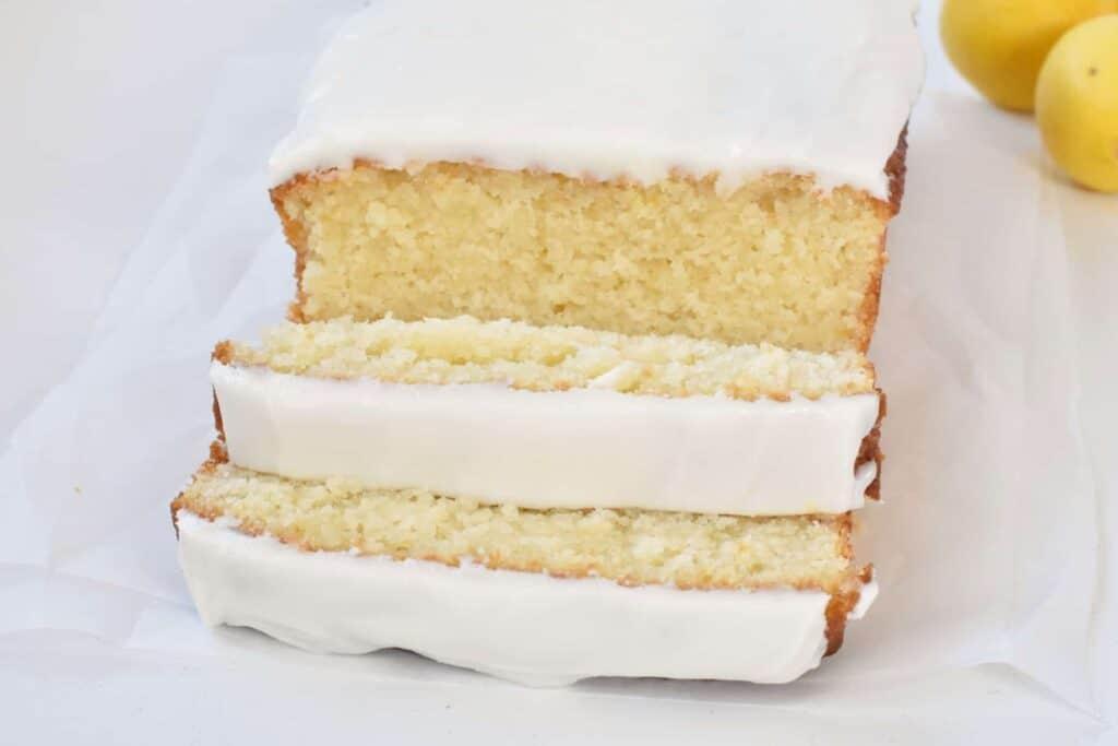 Slices of lemon loaf on baking paper.