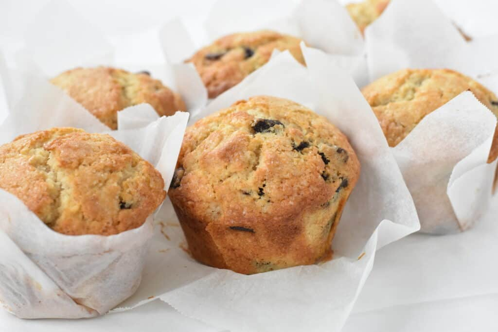 Unwrapped bakery style chocolate chip muffins.