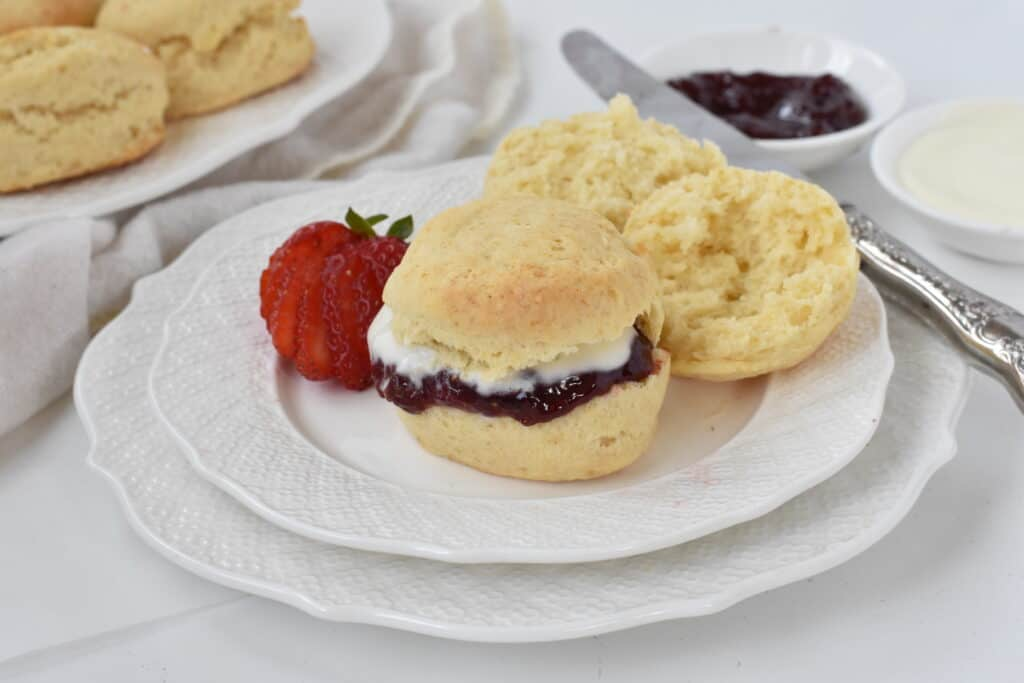 Scone halved with jam and cream in the middle.