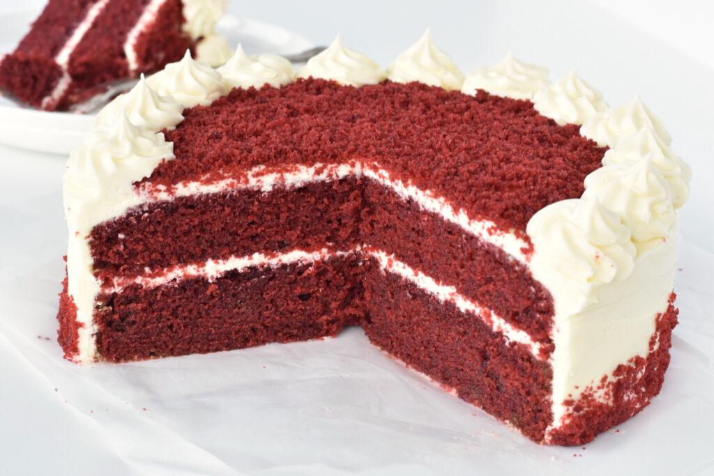 Large wedge of red velvet cake.