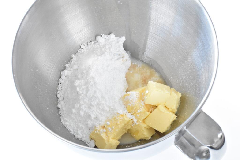 Buttercream ingredients in mixer bowl