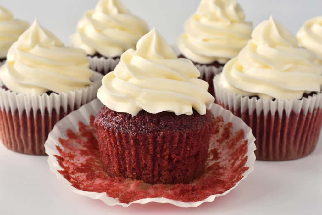 Red velvet cupcakes with cupcake wrapper pulled off.